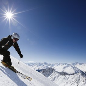 Male skier with mountain view